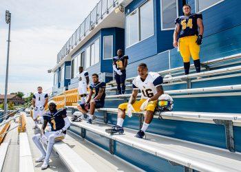 football players on bleachers